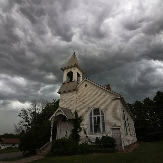 Church with storm clouds in background